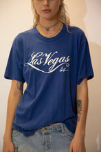 Load image into Gallery viewer, Blue in colour with a large white print of Las Vegas printed across, pair this cute single-stitch tee with dark wash jeans and Airforce 1s for a laidback fit!