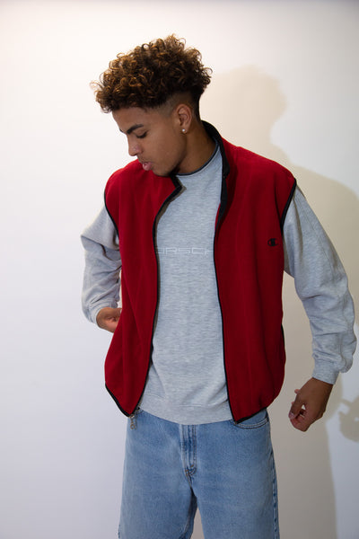 the model wears a red champion vest