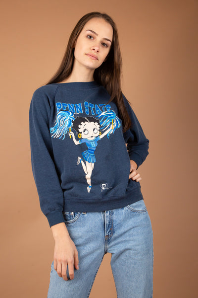faded navy sweater with graphic of the iconic betty boop in a little cheerleading fit on the front
