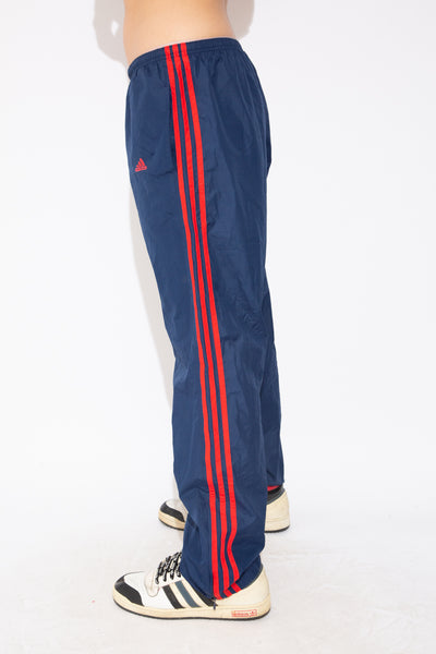 model wearing adidas trackpants, magichollow