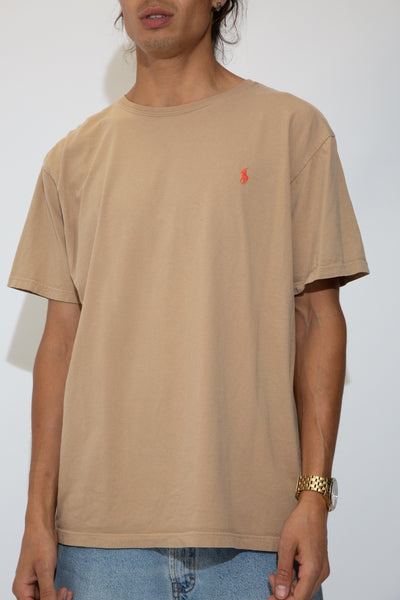 beige tee with orange embroidered ralph emblem on left chest