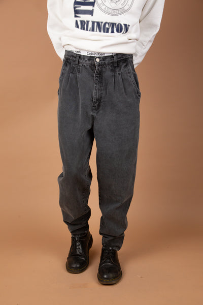 faded black jeans in a baggy to tapered fit with pleated detailing
