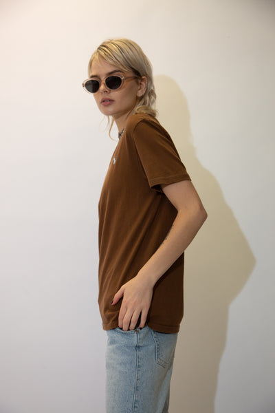 Brown in colour, this tee has a crew-neck cut and baby blue Ralph Lauren branding embroidered on the left chest.