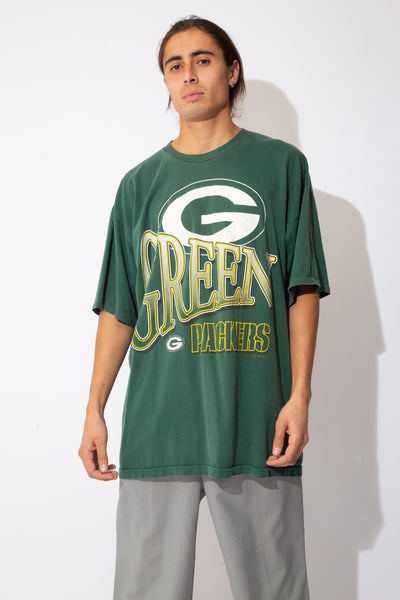 oversized faded green tee with large green bay packers spell-out graphic on front and back