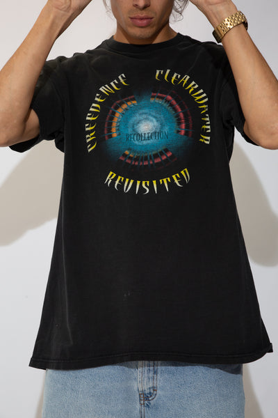faded black tee with colourful circular CCR text graphic on front