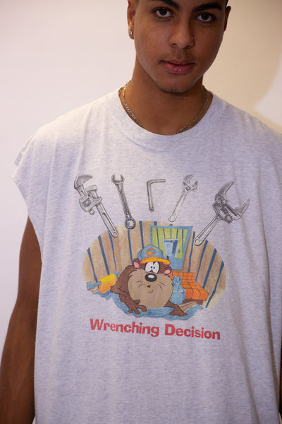 Grey in colour, this tee has a colour print of Taz in water. 'Wrenching Decisions' is printed below in red with a variety of wrenches above him.