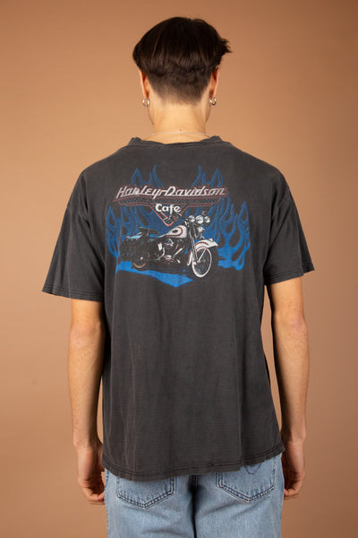 boxy faded black tee with harley davidson text graphic on front pocket and across back