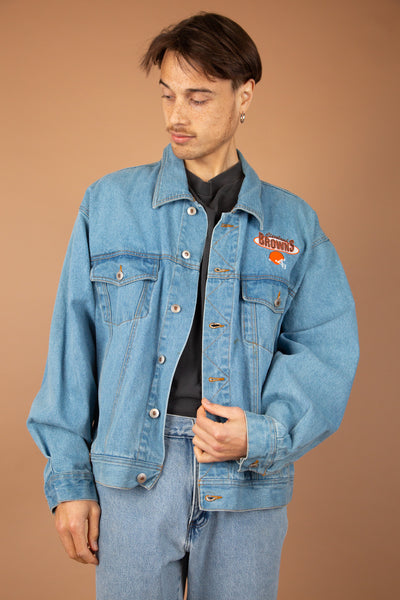 light/mid-wash denim jacket with embroidered cleveland browns details on left chest and across back
