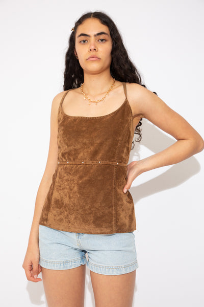This brown suede-like top has straps that criss-cross over at the back and create a halter neckline . Finished off with small metal domes around the waist