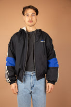 Load image into Gallery viewer, thick black adidas jacket with iconic 3 stripe detail down sleeves and embroidered logo