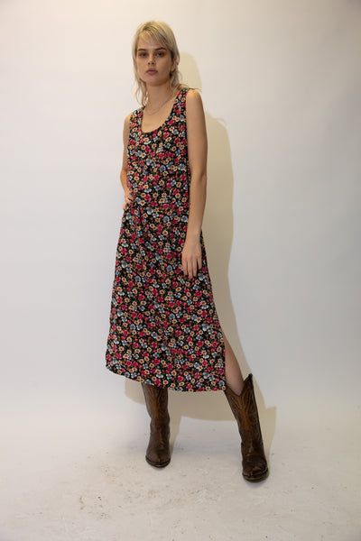 With a crew neck cut and an a line style, this maxi dress has slits up the side and an all over floral pattern in pinks and blues.
