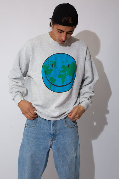 oversized grey-marle sweater with cute af graphic of a happy smiley planet on front