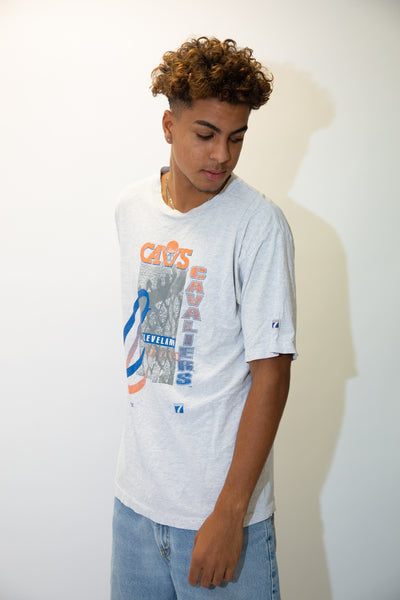Grey in colour, this single-stitch tee has a large print repping the Cavs on the front in orange and blue, their signature colours before their change in 2003.