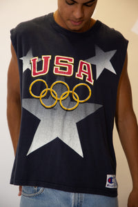Navy blue in colour, this singlet has a large colour print repping USA in red and the olympic logo in gold. Finished off with a Champion plaque on the left/bottom.
