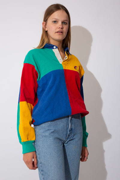 multicolour-panelled rugby jersey with embroidered rainbow detail on left chest