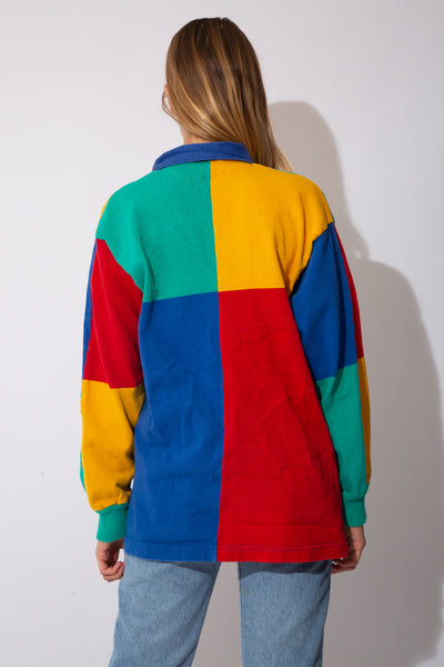 multicolour-panelled rugby jersey with embroidered rainbow detail