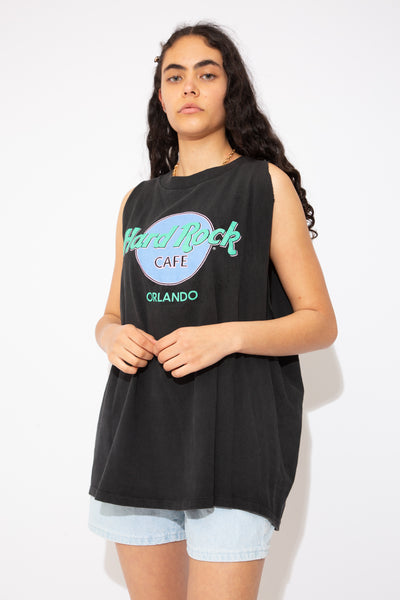 Faded black singlet with mint green, lilac and baby pink Hard Rock Cafe logo on the front. Represent Orlando, Florida in this vintage tee!