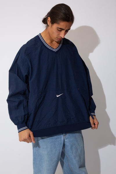 navy nike windbreaker pullover with embroidered tick detail on front pocket