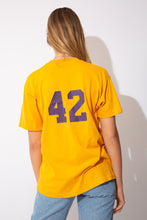 "Load image into Gallery viewer, yellow tee with ""Karns City 42"" on the front and number 42 on the back as well (in purple)"