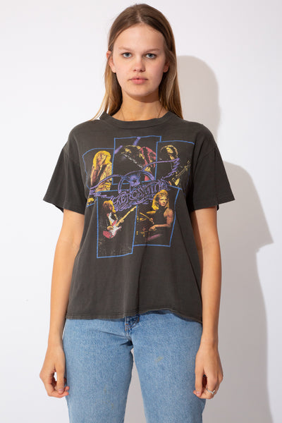 The model is wearing a faded black tee, the tee features the iconic band Aerosmith on the front, and the bands back print on the back