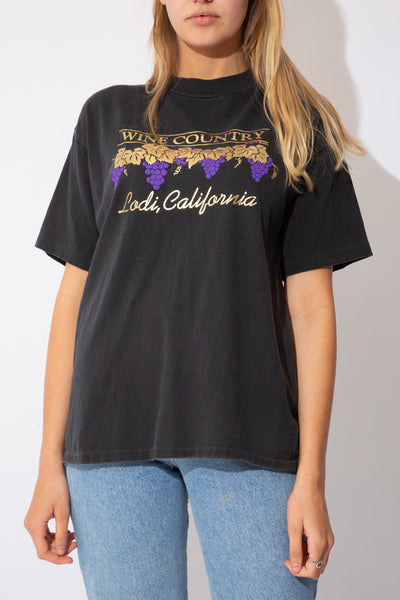 black tee with Wine country and grapes graphic on the front