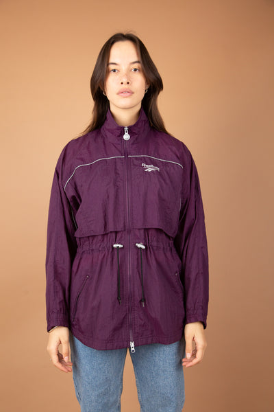 Model wearing Reebok jacket, Magichollow