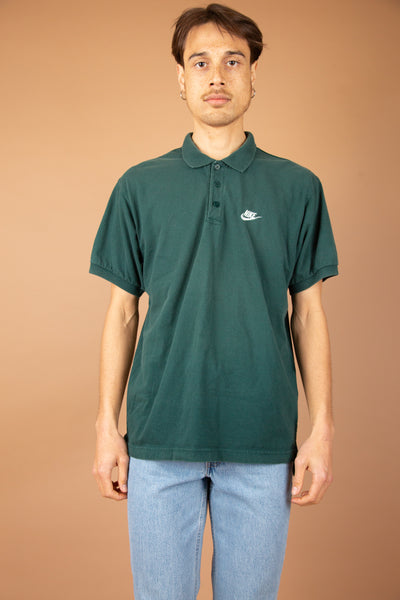 Green polo-tee with white nike logo on the front left chest. 90's vintage at magichollow