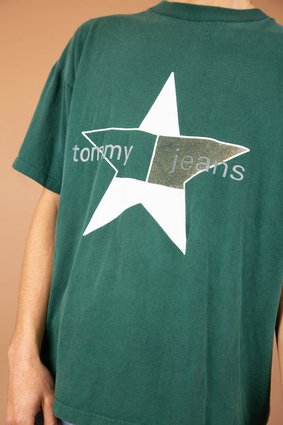 green boxy-fitting tee with tommy jeans star graphic on the front. vintage at magichollow