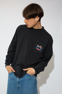 A black long-sleeved tee with a motorcycle print on the left pocket and dated 1996. On the back, a large print of a motorcycle, the Harley Davidson logo and 'that sweet sound' printed below.