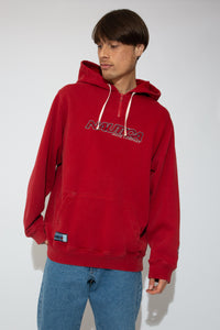 This red sweater has a kangaroo-pouch style pocket, a quarter zip, a hood and adjustable draw strings! Finished off with Nautica branding on the front, left arm and pocket.This red sweater has a kangaroo-pouch style pocket, a quarter zip, a hood and adjustable draw strings! Finished off with Nautica branding on the front, left arm and pocket.