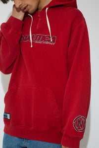 This red sweater has a kangaroo-pouch style pocket, a quarter zip, a hood and adjustable draw strings! Finished off with Nautica branding on the front, left arm and pocket.