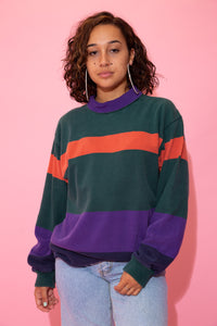 the model wears a striped rugby