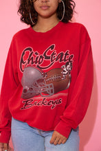 Load image into Gallery viewer, the model wears a red sweater with an ohio state buckeyes graphic and spell out on the front