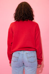 the model wears a red sweater with an ohio state buckeyes graphic and spell out on the front