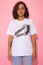 Load image into Gallery viewer, the model wears a white tee with a chocoholiday volunteer spell-out