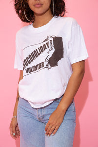 the model wears a white tee with a chocoholiday volunteer spell-out