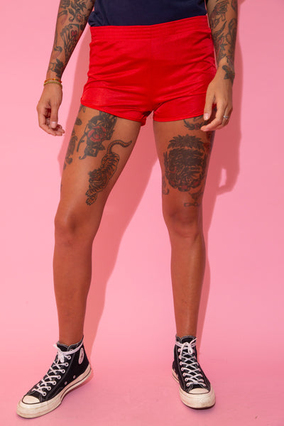 Red in colour in a silky material, these must have booty shorts have an elasticated waistband and supportive inner layer.
