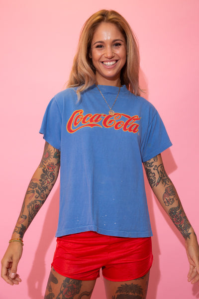 Blue in colour, this single stitch tee has a large 'Coca Cola' spell-out across the front in red and yellow.