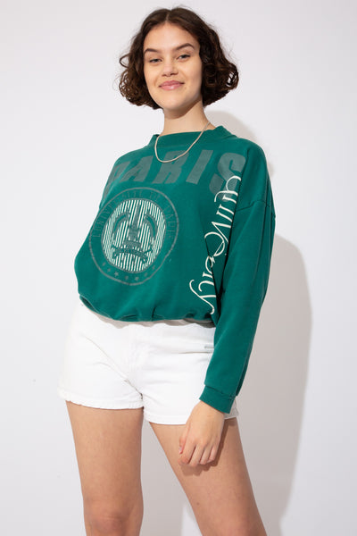 Dark green sweater with 'Paris' printed across in dark green and University printed vertically in white. Finished off with the Paris University logo. Stretched out neckline adds to 80's baggy fit