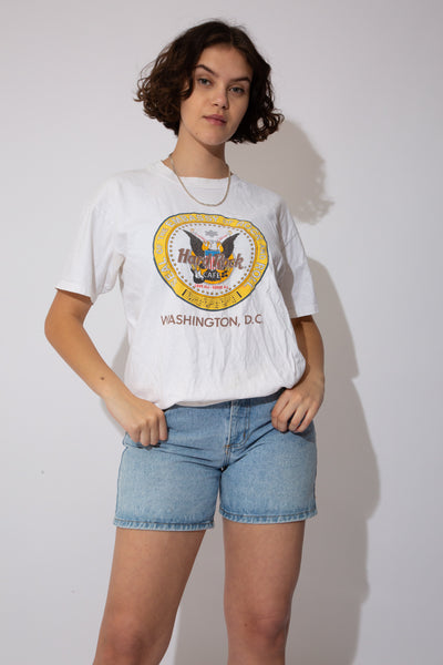 White single-stitch tee with a giant Seal of the Embassy of Rock and Roll on the front. Repping Washington D.C. at the bottom.