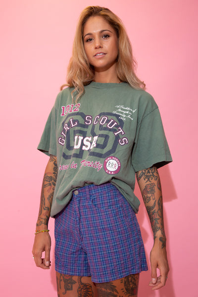 Khaki green in colour, this single-stitch tee has a large white and maroon print repping Girl Scouts USA. Dated 1912 with the slogan, 'Strength in Diversity'