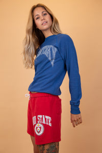 "blue sweater with ""Kentucky"" written over the front in white"