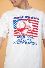 Load image into Gallery viewer, White, single-stitch tee with 'Aunt Rosie's Amherst Girls Softball Tournament' printed in blue, an American flag and a baseball flying in front of it.