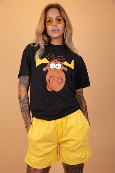 The model is wearing a Rocky Bullwinkle promo tee by Taco Bell. The shirt features the cartoons face on the front and the Taco Bell lovers logo on the back
