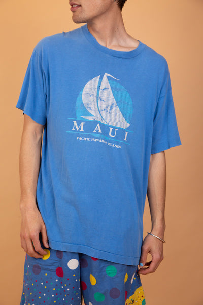 Blue tee with a white sailing boat print on the front and 'Maui Pacific Hawaiian Islands' printed below. Finished off with single stitching and a distressed stretched out neckline.