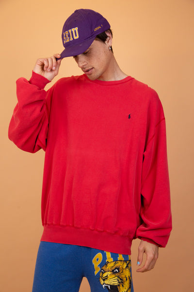 Red crew neck sweater with black Ralph Lauren branding on the left chest and a stretched out neckline, adding to the baggy fit.