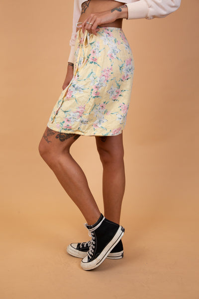 yellow skort with pink and green floral pattern on it