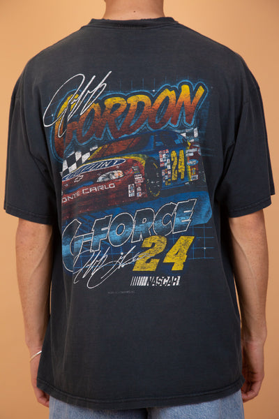 This distressed DuPont Racing Tee is black with a vertical red print of Gordon on the front, repping DuPont Automative Finished Racing. On the back, a large car print, G Force 24 and 'Jeff Gordon' printed across - dated 1998.