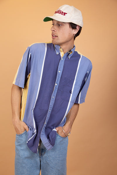 Nautica Button-Up with blue, white and yellow vertical stripes, pearly white closing-buttons and dark blue branding on the left chest.