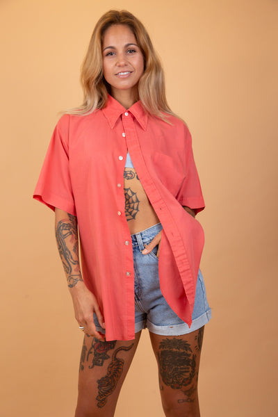 Salmon pink coloured button-up shirt
